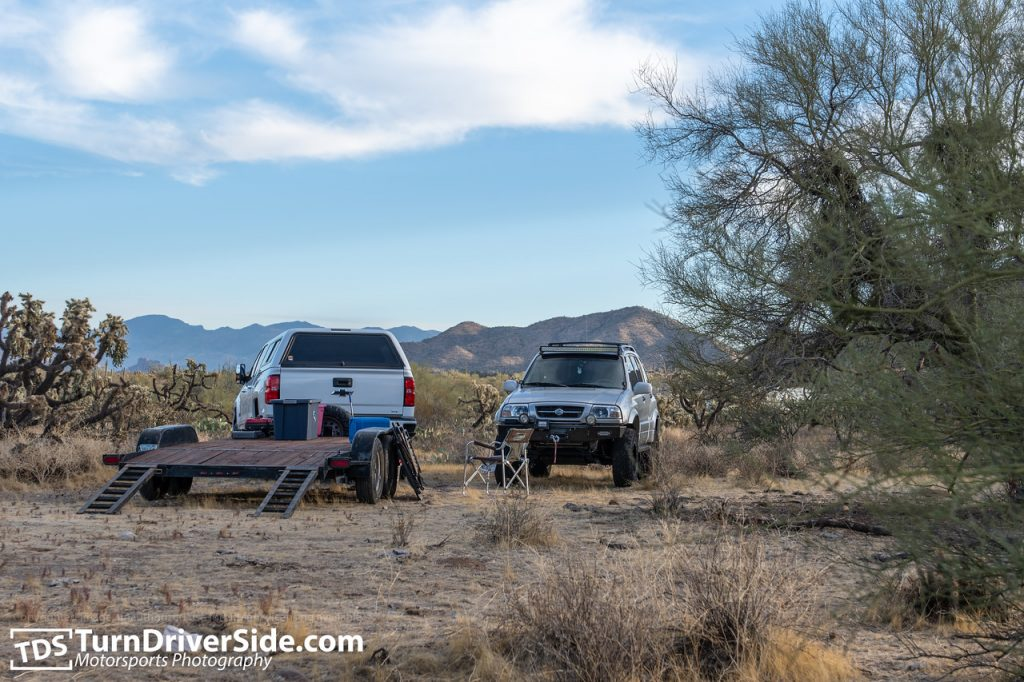 Suzuki Grand Vitara and a Chevy Silverado 2500 at Mineral Mountain Road campground.