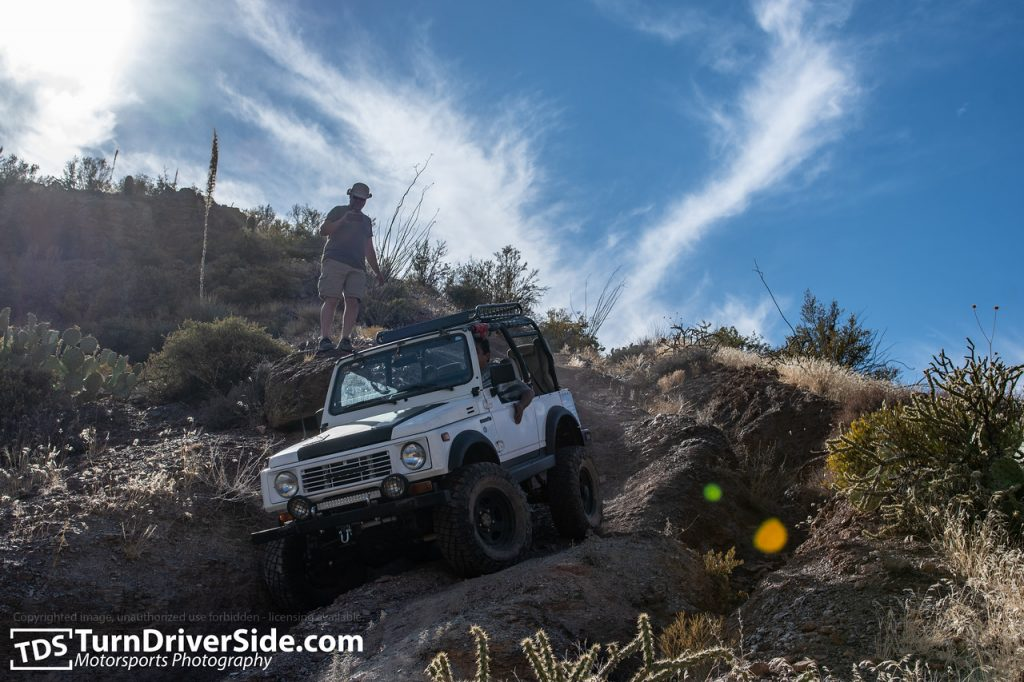 Gilbert driving his white propane powered Suzuki Samurai down the most rutted out section of Flat Tire Canyon Trail.