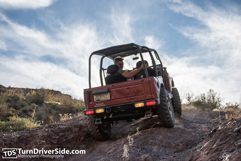 Curtis driving his Suzuki Samurai down the toughest obstacle on Flat Tire Canyon Trail in reverse.