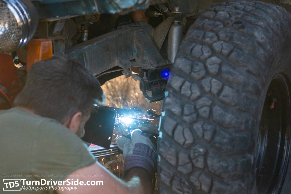 Curtis battery welding Brian's broken tie rod.