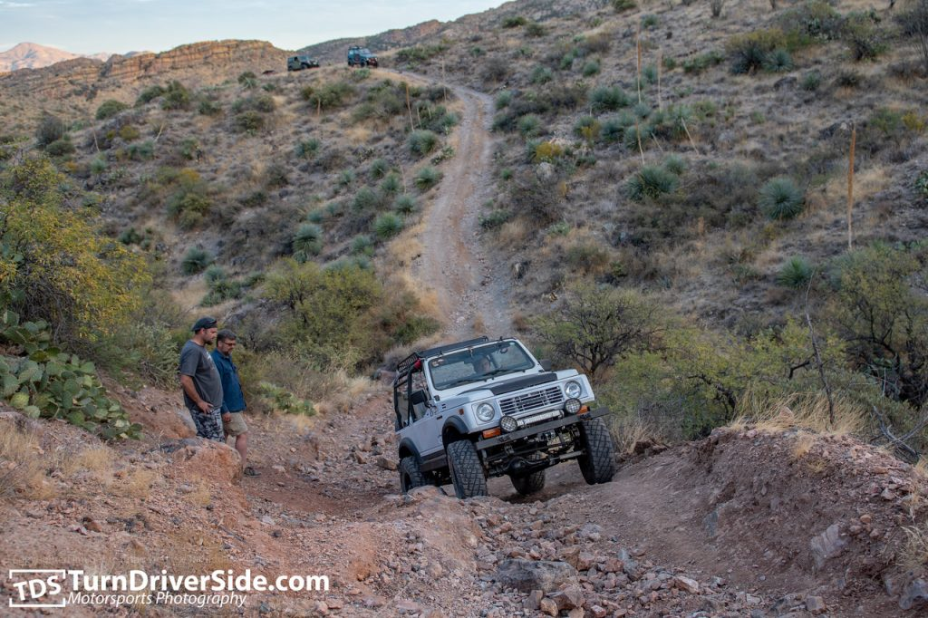 Another angle of Gilbert navigating his propane powered Suzuki Samurai over the last obstacle of the Flat Tire Canyon Trail.