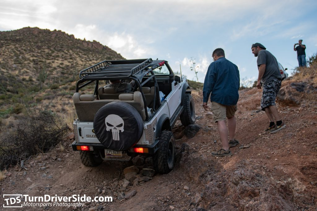 Gilbert navigating his propane powered Suzuki Samurai over the last obstacle of the Flat Tire Canyon Trail.