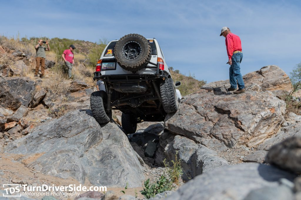 James in his lifted Suzuki Grand Vitara crawling up the firehole on Woodpecker Mine Trail.