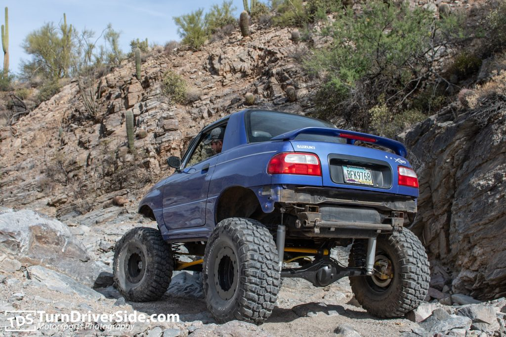 Geno in his lifted Suzuki X-90 on Toyota Axle putting along on the Woodpecker Mine Trail