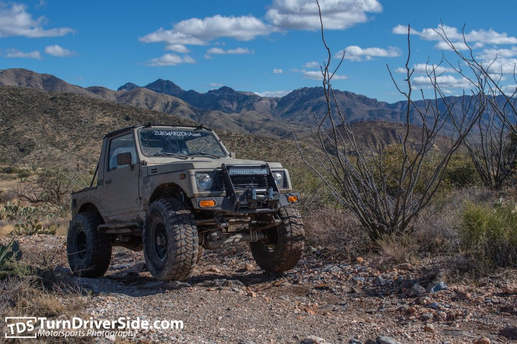 "Daniel in his lifted Suzuki Samurai on 35"" tires and toyota axles on the Pucker Ridge Trail"