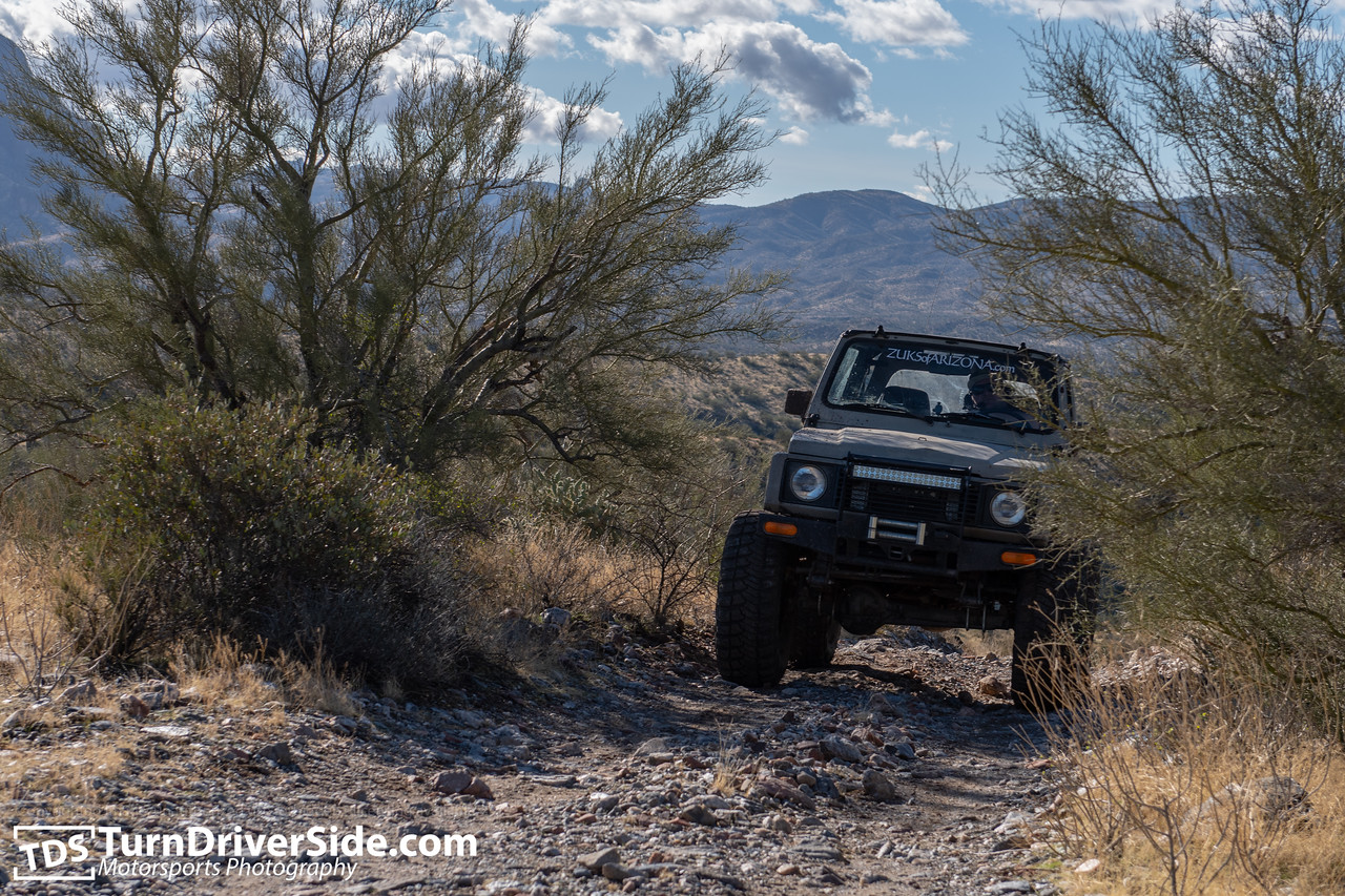 Daniel in his Suzuki Samurai getting some body lean on the Pucker Ridge Trail.