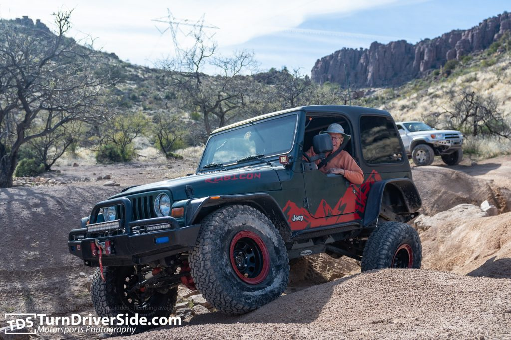 Jim Kawa flexing his Jeep Wrangler's suspension right around the lunch area
