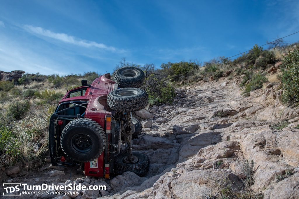 Winching back over from a roll-over on the switch back sections of the trail