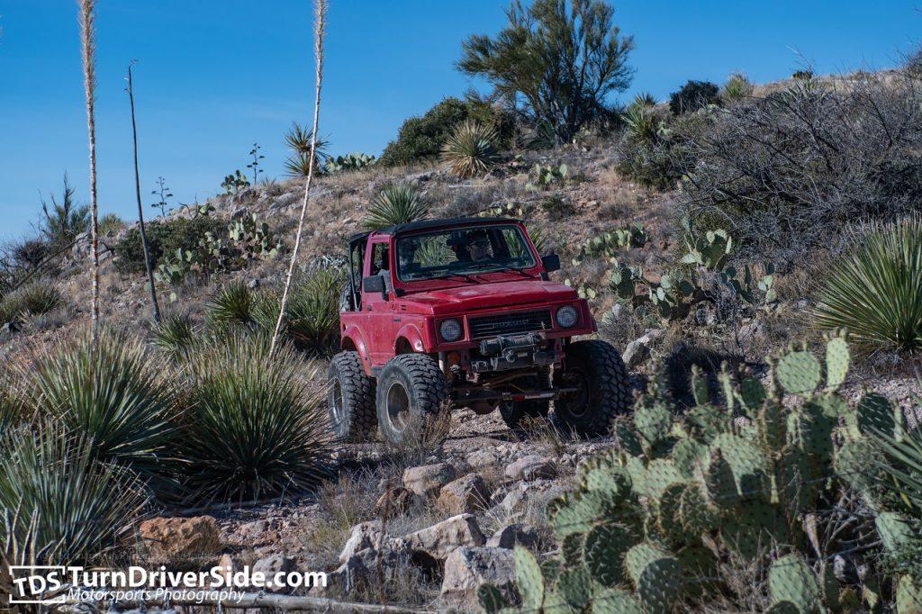 Red Suzuki Samurai on Hackberry Creek Traill