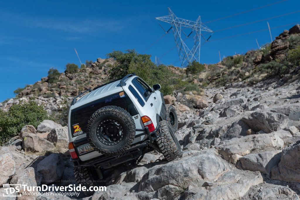 James in his Suzuki Grand Vitara with a three link climbing the power-line hill on Hackberry Creek Trail