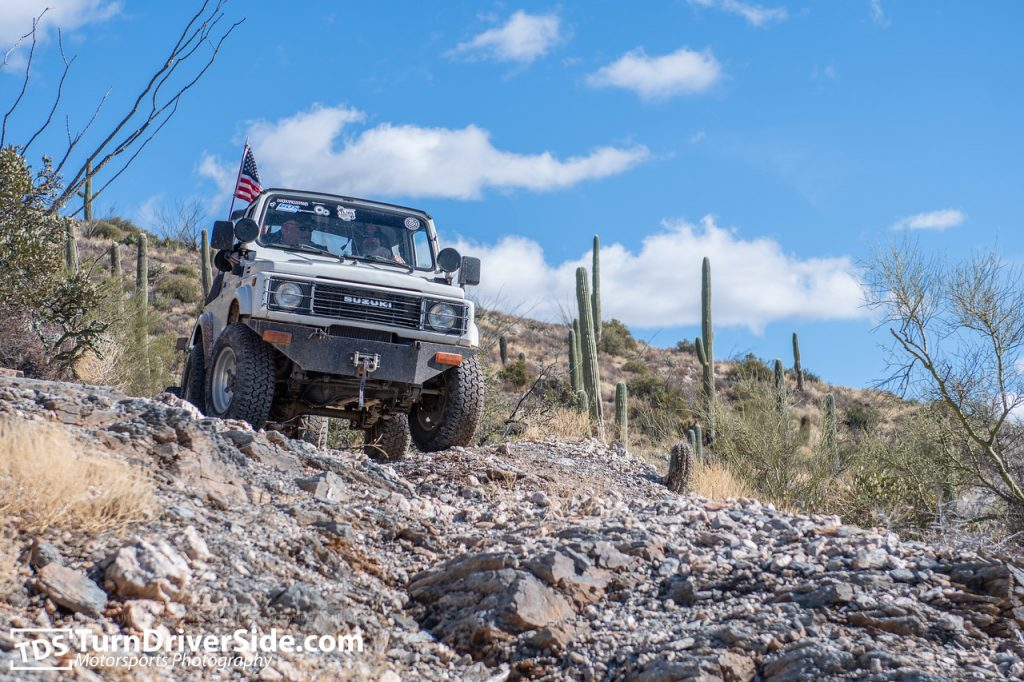 Rob in his white Suzuki Samurai on the Pucker ridge trail, showing about the worst parts of the trail