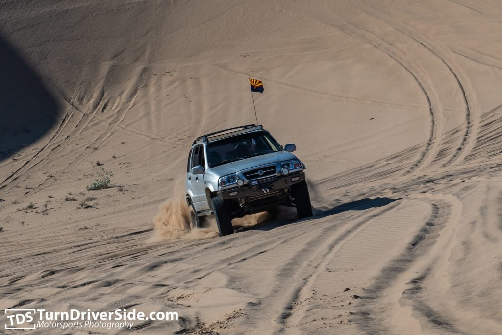 climbing up glamis sand dunes in a suzuki grand vitara